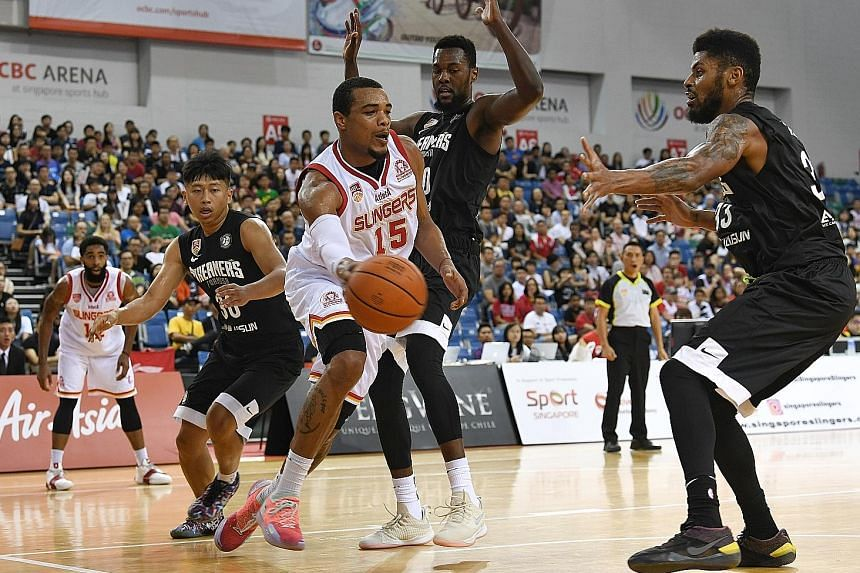 Singapore Slingers' Xavier Alexander trying to get past three Formosa Dreamers players in yesterday's Asean Basketball League game, which the Chinese Taipei team won 77-73.