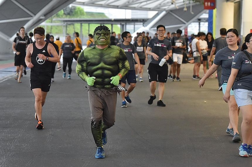 Enthusiastic participants waiting for the rain to stop. Unfortunately, for the first time in its 25 editions, the Big Walk had to be cancelled due to lightning risk. A participant, dressed as The Hulk, did not let the rain stop him from keeping fit,