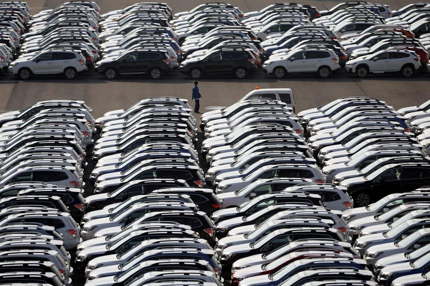 File photo of newly manufactured cars awaiting export at a port in Yokohama, Japan.