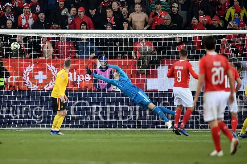 Switzerland's forward Haris Seferovic (third from right) scores his team's fifth goal against Belgium's goalkeeper Thibaut Courtois during the UEFA Nations League, league A, group 2 football match between Switzerland and Belgium at the Sporangiospore