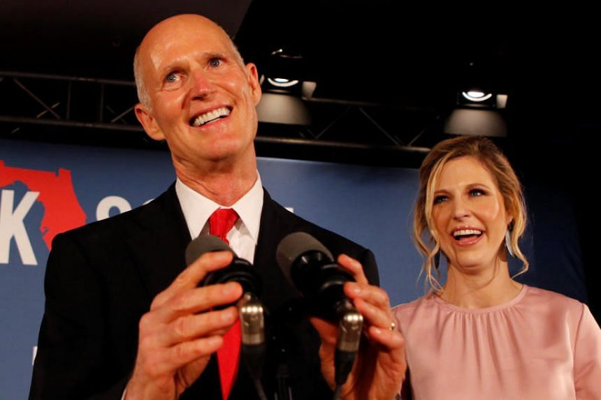 Republican US Senate candidate Rick Scott is accompanied by his daughter Allison Guimard as he addresses supporters at his midterm election night party in Naples, Florida, on Nov 6, 2018.
