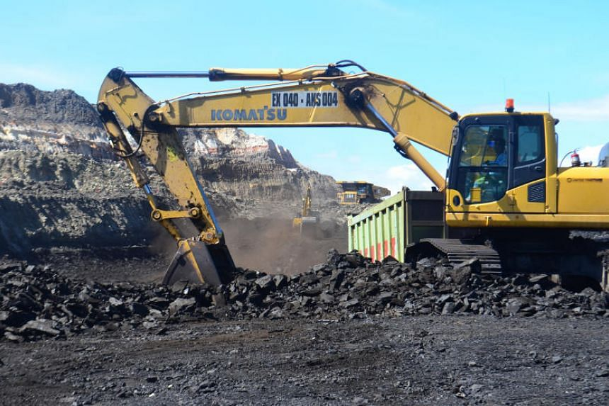 Excavators at work in Golden Energy and Resources' coal mine in South Kalimantan.