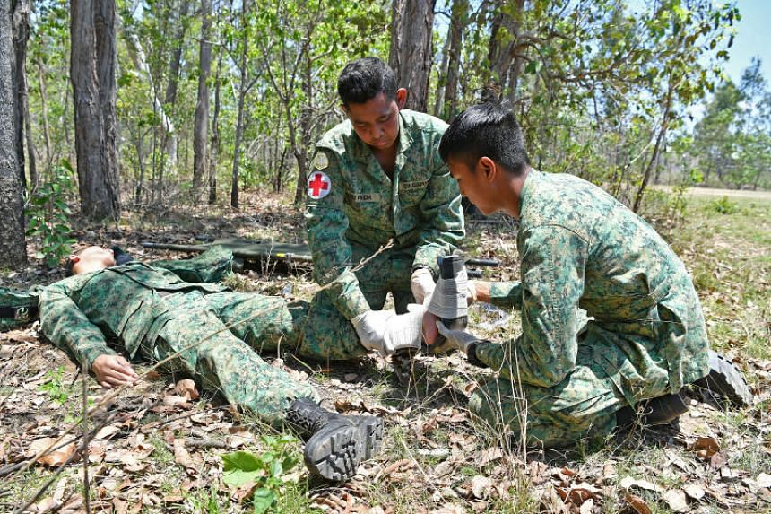 "Singapore Armed Forces (SAF) medics attend to a ""casualty"" during field training as part of Exercise Wallaby in Rockhampton, Australia. Defence Minister Ng Eng Hen said the higher compensation amounts for injuries or deaths arising from SAF training"