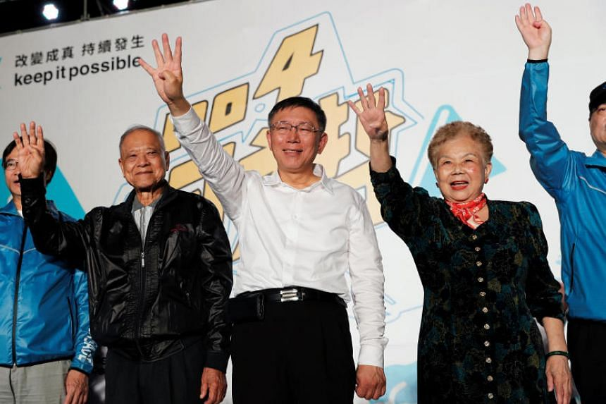 Dr Ko Wen-je (C), Taipei mayor who is seeking a re-election, seen with his parents during a campaign rally in Taipei, Taiwan, on Nov 10, 2018.
