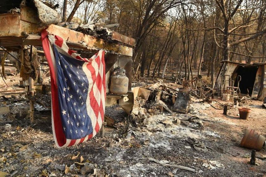 An American flag hangs at a burned out mobile home park in Paradise, California, on Nov 18, 2018.