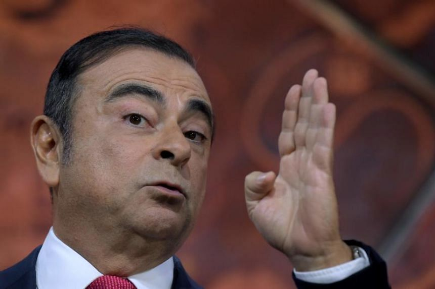 Carlos Ghosn, Renault-Nissan chairman and CEO, gestures as he addresses a press conference in Paris on Sept 15, 2017.