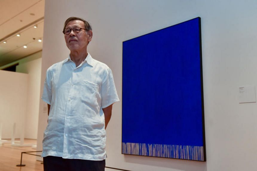 Artist Tadaaki Kuwayama, who is 86 this year, poses with his work, Blue TK684-60.