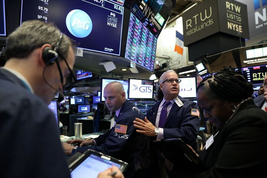 Traders work on the floor of the New York Stock Exchange, Nov 20, 2018.