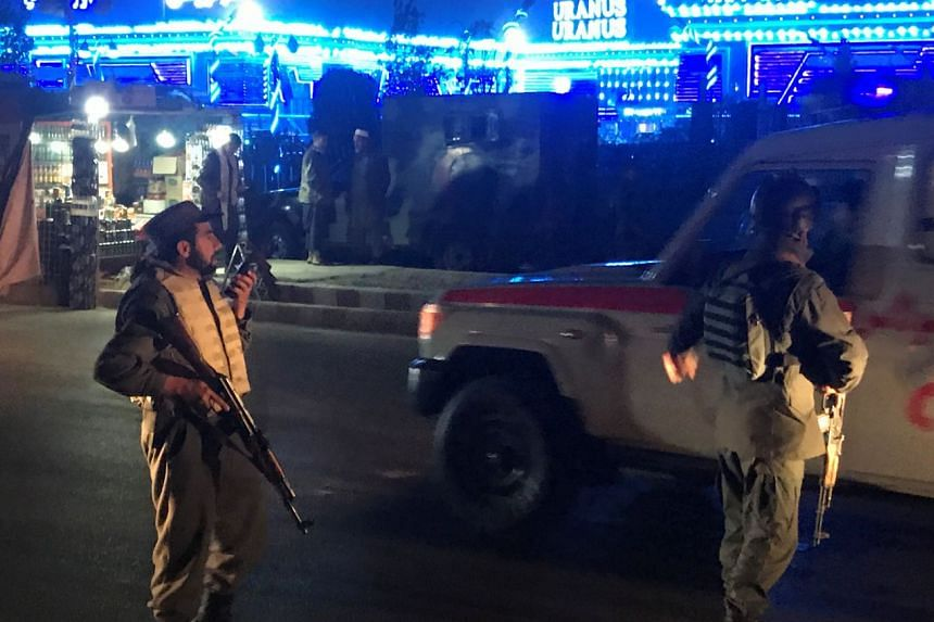 Afghan police keep watch at the site of the attack in Kabul.