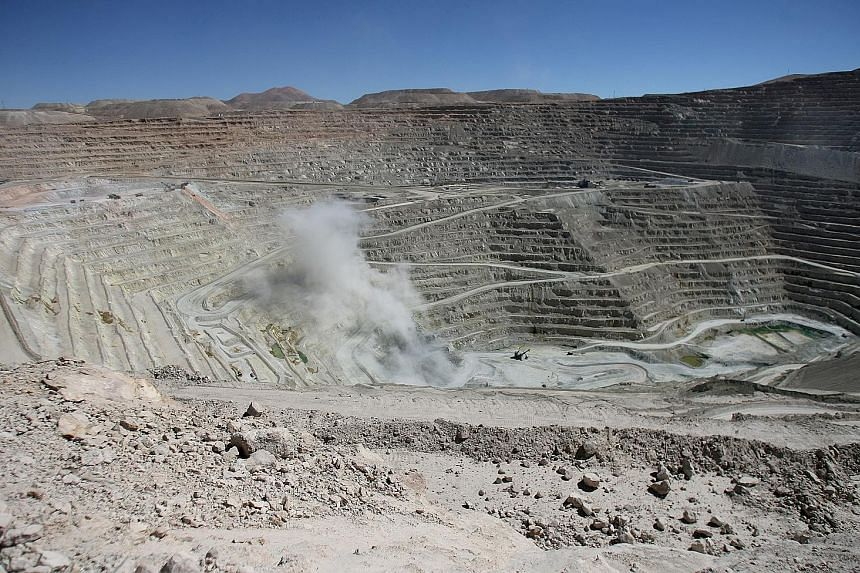 BHP's copper mine in Antofagasta, northern Chile (right). The mining giant will raise its stake in BHP Billiton Marketing, which is the main company conducting its Singapore marketing business, to 100 per cent from 58 per cent. The change in ownershi
