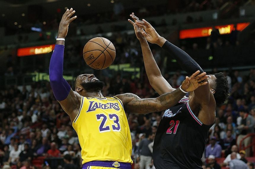 47dd4d1a1ec Lakers forward LeBron James is defended by Heat centre Hassan Whiteside  during their NBA game in