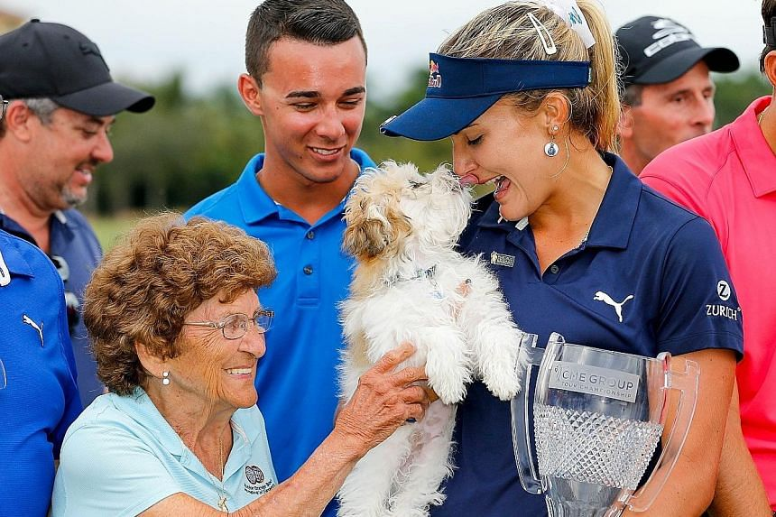 Lexi Thompson kissing her dog Leo after winning the season-ending LPGA Tour Championship at Tiburon Golf Club on Sunday in Naples, Florida by four strokes. She has won at least one LPGA title for six straight years.