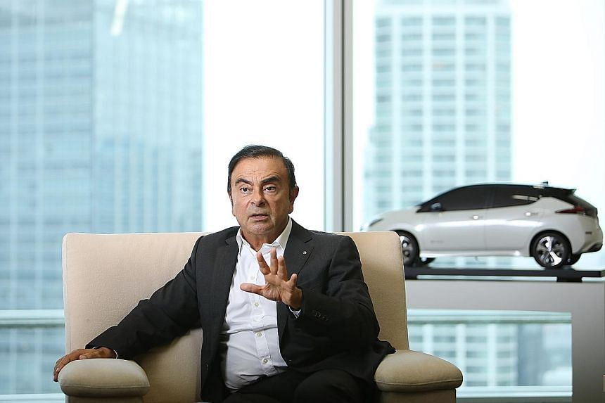 Mr Carlos Ghosn, seen here giving an interview in September at Nissan's headquarters in Yokohama, is said to have under-reported nearly 10 billion yen (S$122 million) in compensation as around five billion yen. Mr Ghosn is also the chief executive of