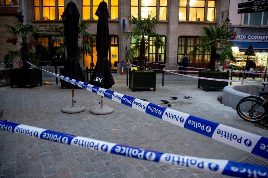 Police ribbons are pictured at the police station in Brussels, after a man attacked police officers with a knife.
