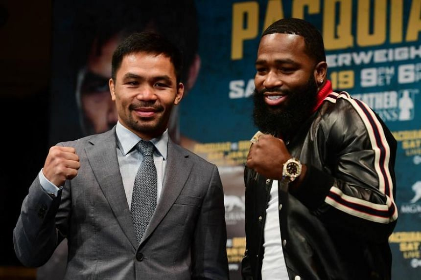 Manny Pacquiao (left) and Adrien Broner face off during a press conference at Gotham Hall in preparation for their upcoming match on Nov 19, 2018 in New York City.