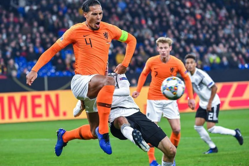 Netherlands' defender Virgil van Dijk (left) plays the ball during the UEFA Nations League football match Germany v the Netherlands in Gelsenkirchen on Nov 19, 2018.
