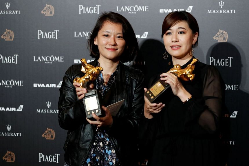Taiwanese director Fu Yue (right) with her Golden Horse Award for Best Documentary in Taipei on Nov 17, 2018. Media reports noted that the live telecast of the awards ceremony was cut off after Fu's acceptance speech.