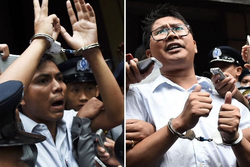 Myanmar journalists Kyaw Soe Oo (left) and Wa Lone being escorted by police after their sentencing by a court to jail in Yangon, on Sept 3, 2018.