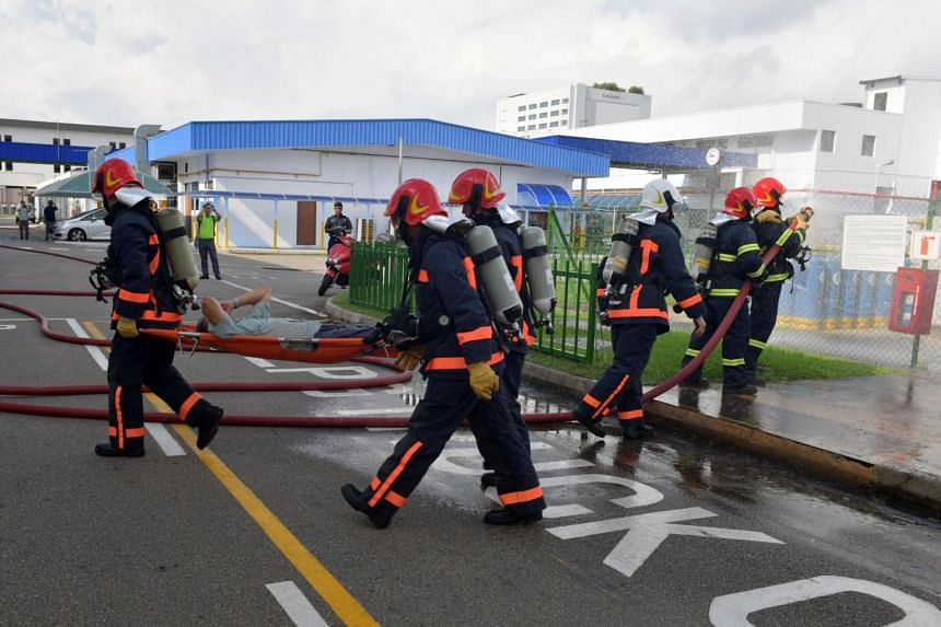 Singapore Civil Defence Force (SCDF) officers participating in an anti-terrorism drill in Bedok South Road on May 16, 2017. Under the Civil Defence (Amendment) Bill, SCDF officers can obtain the fingerprints or other personal information of an uncons