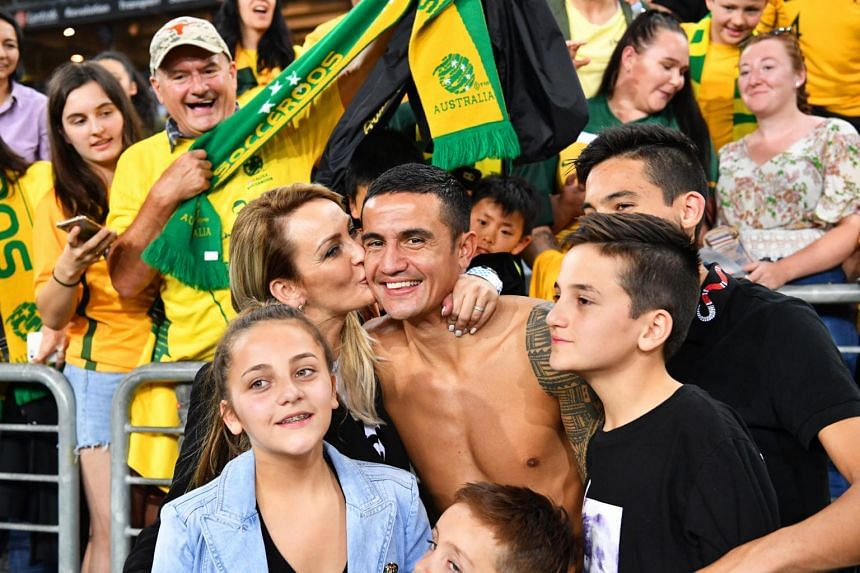 Tim Cahill (centre), flanked by his family, greets fans after the International Friendly soccer match between Australia and Lebanon in Sydney, on Nov 20, 2018.