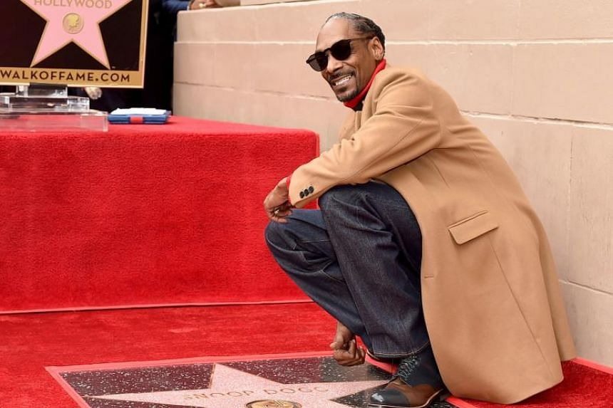 Musician and star Snoop Dogg received a star on the Hollywood Walk of Fame on the 25th anniversary of his debut album Doggystyle.