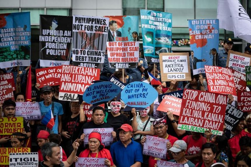 Activists protest in front of the Chinese consular office as Chinese President Xi Jinping arrives in Manila on Nov 20, 2018.