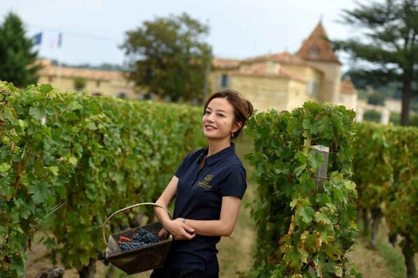 Chinese actress Zhao Wei at her vineyard in Chateau Monlot in France on Sept 18, 2018. Zhao and her husband Huang Youlong have been barred from taking on key positions at listed companies for five years for violating securities regulations.