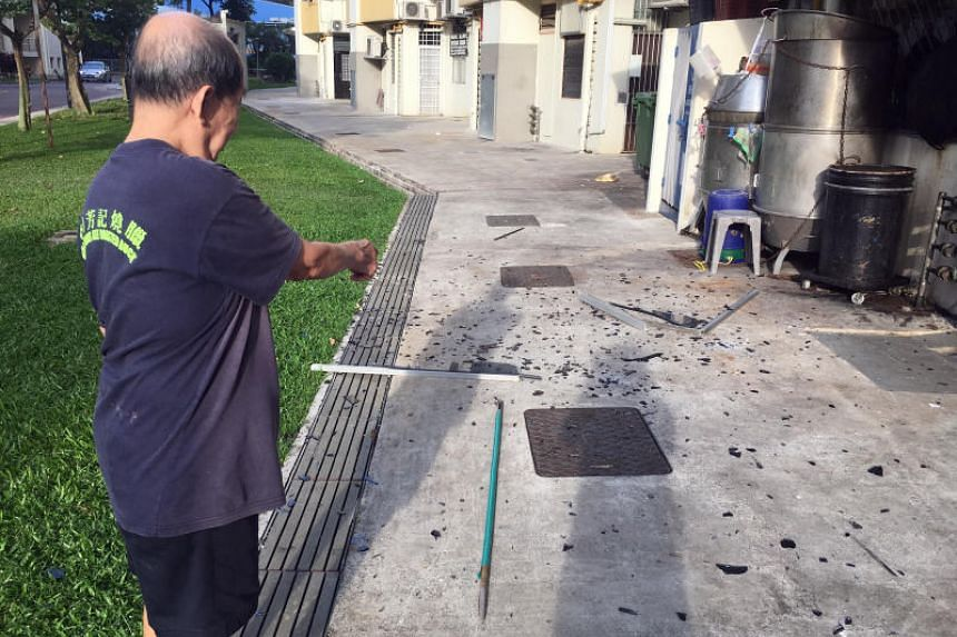 The window panel hit the ground behind a coffee shop at Block 116 Lorong 2 Toa Payoh on Nov 19, 2018.