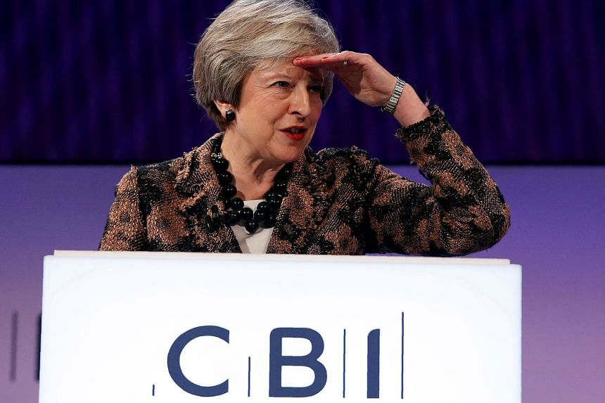 """Britain's Prime Minister Theresa May told the Confederation of British Industry conference in London yesterday that she was """"determined to deliver"""" her Brexit deal."""