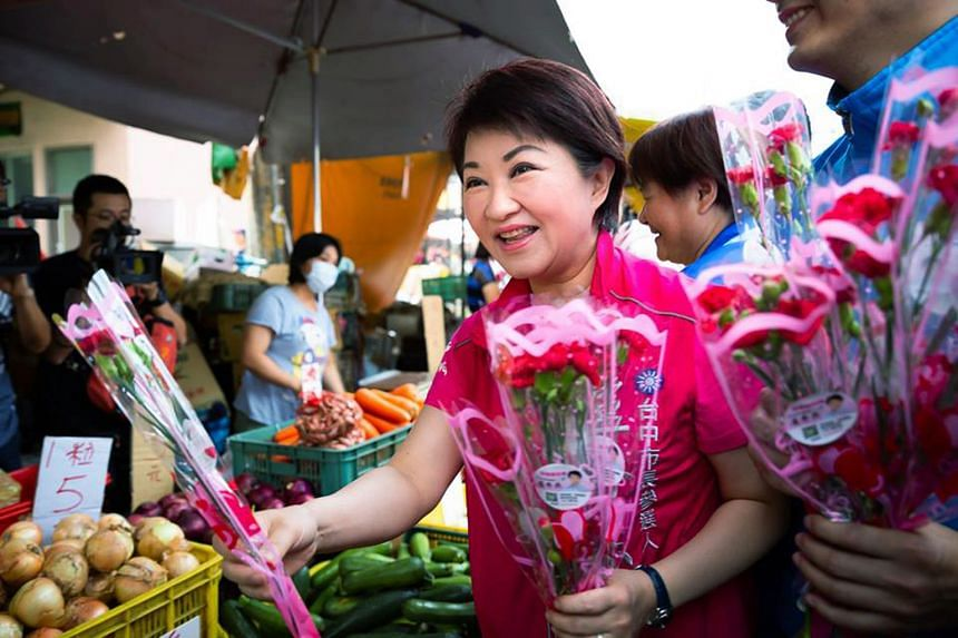 TAICHUNG: Kuomintang's Taichung mayoral candidate Lu Shiow-yen, a former TV journalist and mother of two, giving out roses ahead of Mother's Day which fell on May 13 this year. Campaigning for Taiwan's municipal elections this Saturday began months a