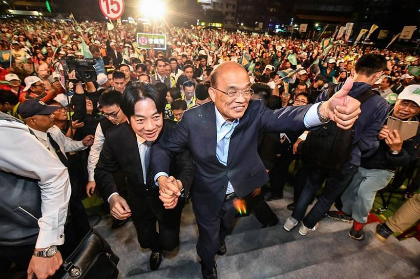 NEW TAIPEI CITY: Taiwan Premier Lai Ching-te with Democratic Progressive Party heavyweight Su Tseng- chang (giving the thumbsup sign), a former premier. The 71-year-old Mr Su is running for mayor in New Taipei City.