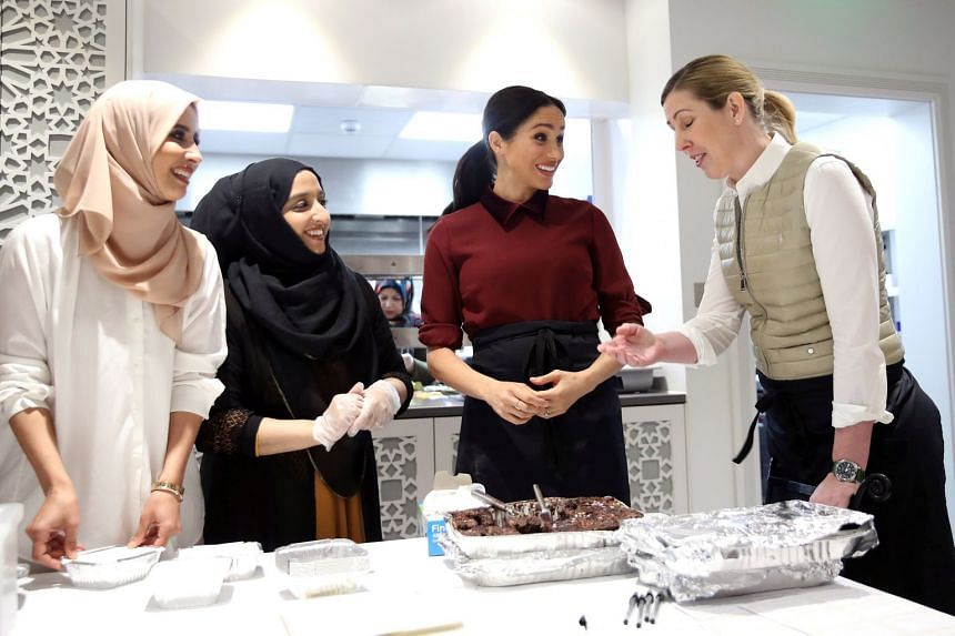 Meghan Markle talking to chef Clare Smyth as she visits the Hubb Community Kitchen in London.