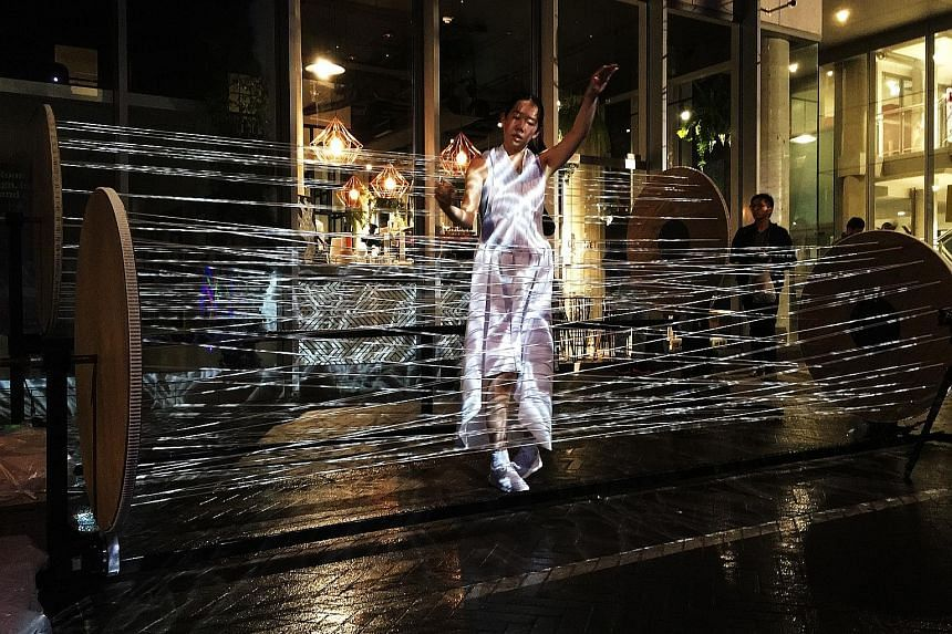 Dancer Anna Kuroda performing in Motion Theory, a work by Australian group Murasaki Penguin in collaboration with Singaporean artist Ong Kian Peng that is part of Adaptations, which will be held at Gillman Barracks.
