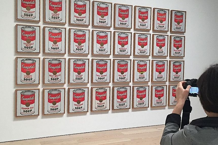 Late American artist Andy Warhol's Campbell's Soup Cans (1962) at the exhibition, Andy Warhol - From A To B And Back Again, at the Whitney Museum in New York.