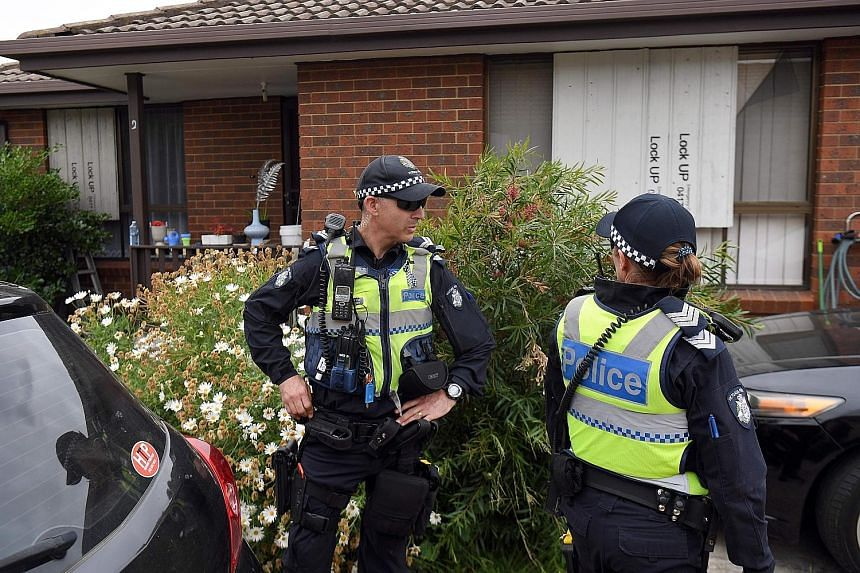 """Police outside a house in a Melbourne suburb that was raided following the arrest yesterday of three men said to have been plotting """"chilling"""" terror attacks in the Australian city."""