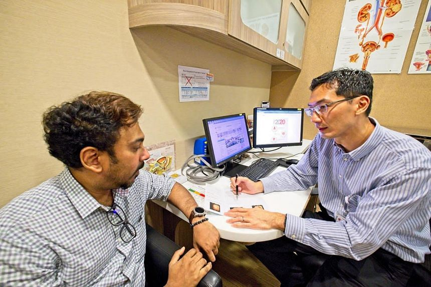 Dr Png Keng Siang (right) in a simulated consultation.
