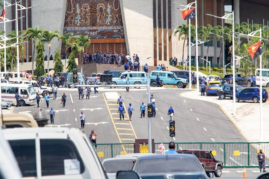 Papua New Guinea police and soldiers outside the country's Parliament in Port Moresby on Nov 20, 2018.
