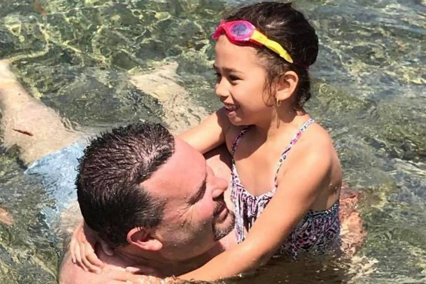 Mr Jason Miller with his seven-year-old daughter Jhayda.