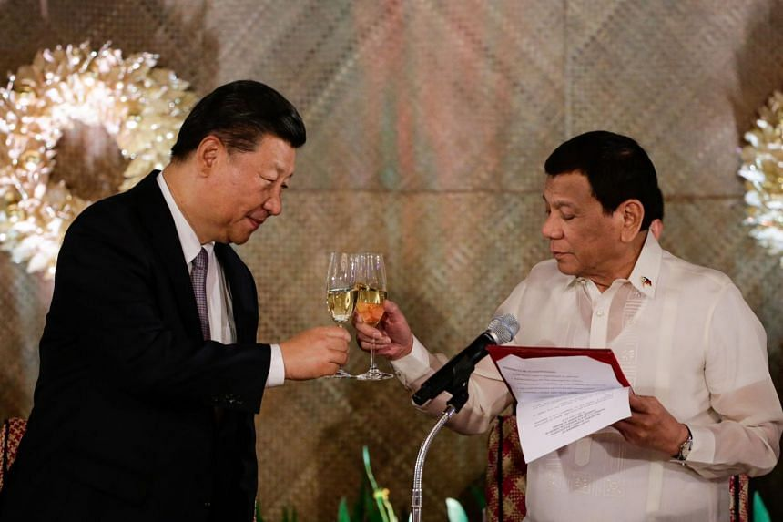 Chinese President Xi Jinping and Philippine President Rodrigo Duterte in a toast during a state banquet at the Malacanang Presidential Palace in Manila on Nov 20, 2018.