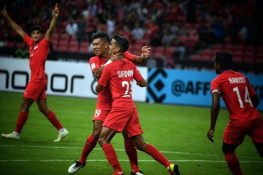 Singapore's Safuwan Baharudin celebrating with teammate Khairul Amri after scoring against Timor-Leste in the AFF Suzuki Cup on Nov 21, 2018.