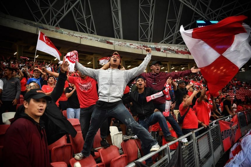 Singapore fans celebrating the Lions' 6-1 victory over Timor-Leste during the AFF Suzuki Cup, on Nov 21, 2018.