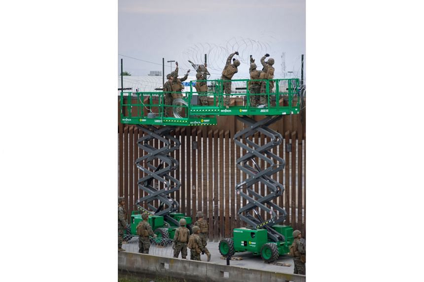 Soldiers fortifying the United States-Mexico border wall at a port of entry in San Diego, California.