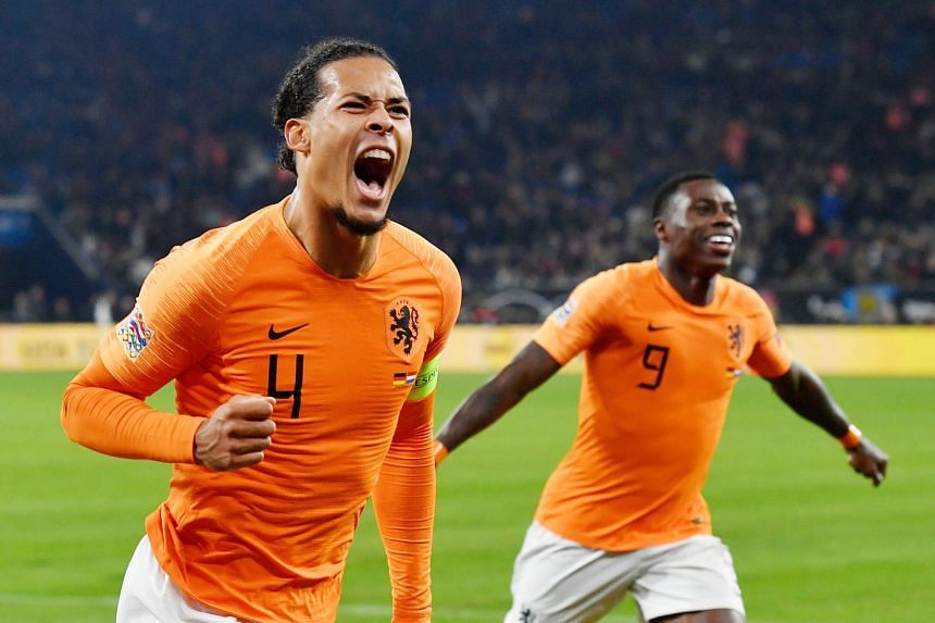 Above: Romanian referee Ovidiu Hategan, whose mother died earlier on Monday, looked distraught at full-time and Virgil van Dijk consoled him. Left: Van Dijk celebrating with Quincy Promes, after the Netherlands captain tied the match at 2-2 against G