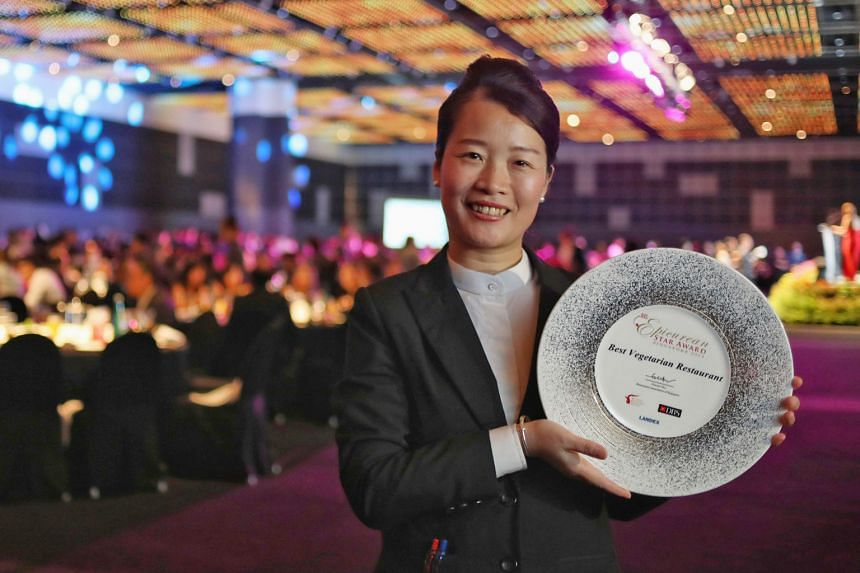 Above: LingZhi's general manager Fanny Chen, 41, with the Best Vegetarian Restaurant award for the eatery at the Restaurant Association of Singapore's annual awards gala at Suntec City yesterday. Left: Mr Hong Junchen, 33, is co-founder of Nude Chill