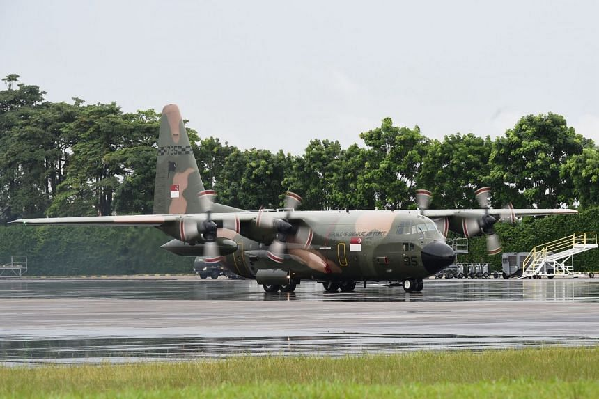 A C-130 transport aircraft departing Paya Lebar Air Base. The Singapore Armed Forces will provide airlift support for rehabilitation and reconstruction efforts at the request of the Indonesian government.