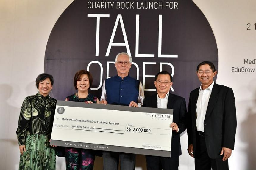 (From left) Mediacorp CEO Tham Loke Kheng, SG Enable CEO Ku Geok Boon, Emeritus Senior Minister Goh Chok Tong, NTUC Fairprice CEO Seah Kian Peng and Mediacorp chairman Niam Chiang Meng at the cheque presentation at the charity book launch of Tall Ord