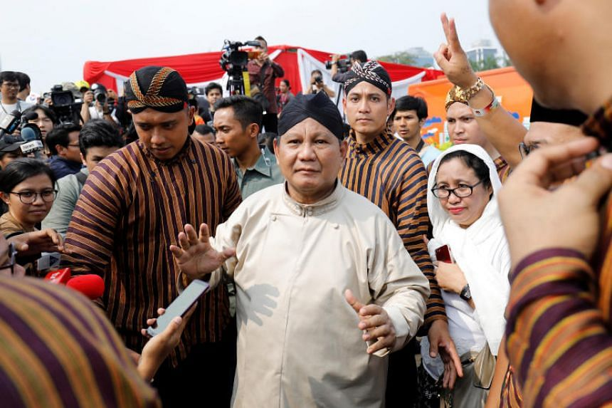 Prabowo Subianto leaves a ceremony marking the start of the campaigning period for next year's election in Jakarta, on Sept 23, 2018.