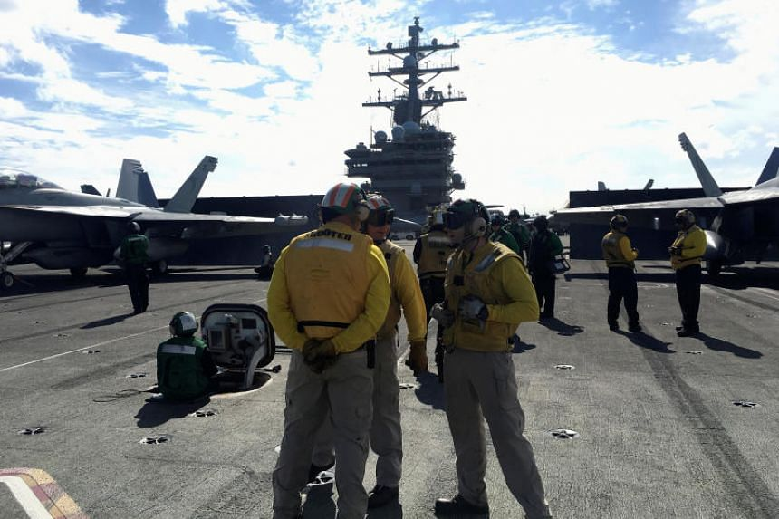 Crew members of the US Navy aircraft carrier USS Ronald Reagan during an exercise at sea on Nov 3, 2018.