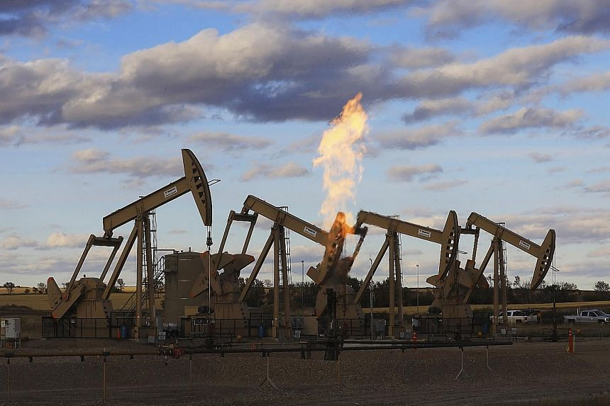 Pumpjacks at an oil well site near Epping, North Dakota. The United States' West Texas Intermediate crude futures ended Tuesday's session down US$3.77, or 6.6 per cent, at US$53.43 per barrel. The contract fell as much as 7.7 per cent to touch US$52.