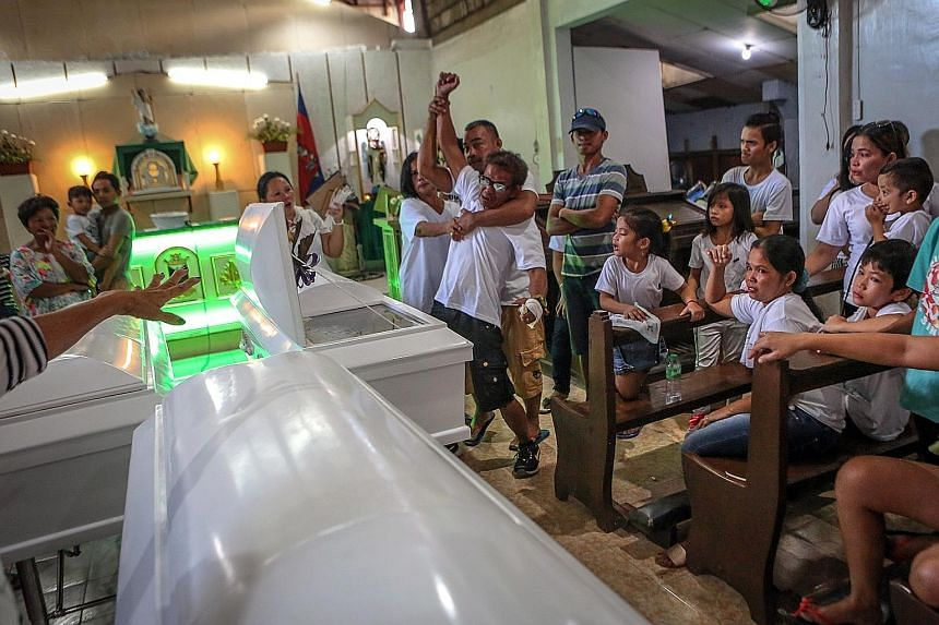 """The father of victim Sherwin Rabasol demanding justice at his son's funeral. Mr Sherwin Rabasol was killed during the """"one-time, big-time"""" anti-drug police operation in Barangay Tangke, Talisay City, in Cebu province on Oct 4."""